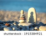 Pebbles Stacked On The Beach