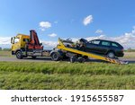 Small photo of After an accident the crashed car is pulled onto a tow truck