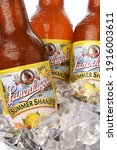 Small photo of IRVINE, CA - JUNE 2, 2015: Closeup of three bottles of Leinenkugel Summer Shandy in ice. Leinenkugel was founded in Chippewa Falls, WI, in 1867 by Jacob Leinenkugel.