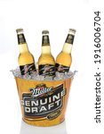 Small photo of IRVINE, CA - JANUARY 15, 2015: A branded ice bucket of Miller Genuine Draft Beer. MGD is actually made from the same recipe as Miller High Life with the exception that MGD is cold filtered.