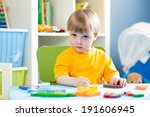 child playing with puzzle toy... | Shutterstock . vector #191606945