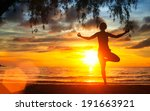 woman practicing yoga on the... | Shutterstock . vector #191663921