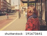 A Young Woman Is Waiting At Th...