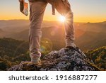 Hiker Standing On Top Mountain...