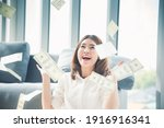 Small photo of Happy young asian woman holding dollar money and throw in the air celebrate happiness dance wealth lottery money rain drop. Winner Success business woman throw cash flow Happy money smiling face