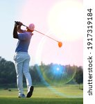 Small photo of Golfers are playing golf at field selective focus background