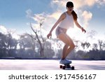 Asian women surf skate or...