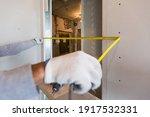 Worker Measures Distance In...