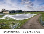 Winter Farm With A Frozen Pond