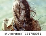 wind blowing hair of beautiful... | Shutterstock . vector #191780051
