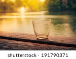 An Empty Glass On A Wooden...