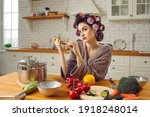 Woman In Funny Curlers Sitting...