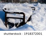 Snow Covered Cast Iron Bench In ...