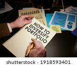 Small photo of Man reads about How to diversify your portfolio for investment and savings.