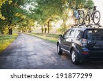 Car With Bicycles In The Fores...