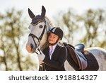 Girl Horse Rider Stroking A...