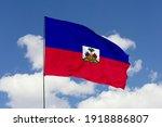 Haiti flag isolated on the blue sky with clipping path. close up waving flag of Haiti. flag symbols of Haiti.