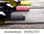 wine bottles on a wooden table | Shutterstock . vector #191911727