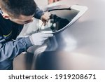 Car wrapping specialist putting ...