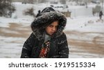 Small photo of Aarsal, Beqaa Lebanon - 2 18 2021: Little Syrian Refugee Girl in a Refuge Camp in Irsal at Syrian Lebanese Borders in Snow Storm Weather Conditions