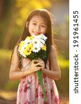 Smiling Asian Girl Hold Flower...