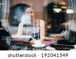 young woman talking on phone... | Shutterstock . vector #192041549