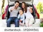 family in car showing thumbs up | Shutterstock . vector #192044561