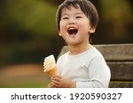 Image Of A Boy Eating Soft...