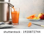 Carrot Juice Is Poured From An...