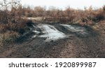 dark rural dirt road with mud... | Shutterstock . vector #1920899987