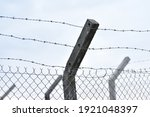 Barbed Wire Fence To Prevent...