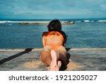 Woman in orange bikini watching ...