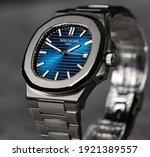 Small photo of Bangkok, Thailand 21 February 2021; Patek Philippe Nautilus 57111A Closeup photo. Blue dial. Luxury watch. Most hyped watch in 2021.