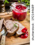 Venison served with cranberry sauce - stock photo