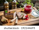 Healthy venison with cranberries and rosemary - stock photo