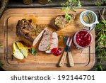 Venison and baked potato served with cranberry sauce - stock photo