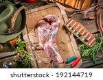 Fresh red venison meat with rosemary and pepper - stock photo