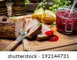 Venison with rosemary served with cranberry sauce - stock photo