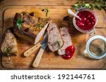 Venison with cranberry sauce in the forester - stock photo