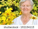 Senior Woman In Garden Full Of...