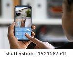 watching cctv home video on... | Shutterstock . vector #1921582541