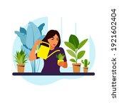 woman watering houseplants at... | Shutterstock .eps vector #1921602404