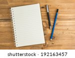 Stock photo blank notebook with pen and pencil on wooden table business concept 192163457