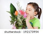 Cute Little Girl Smelling...