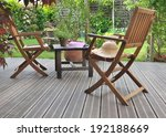Chairs And Table In A Wooden...