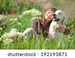 woman playing with her dog... | Shutterstock . vector #192193871