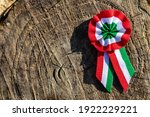 Small photo of close up tricolor rosette symbol of the hungarian national day 15th of march