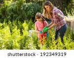 mother and daughter watering... | Shutterstock . vector #192349319