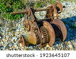 Rusty Old Winch On Pebbly Beach....