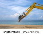 Yellow Backhoe With Hydraulic...